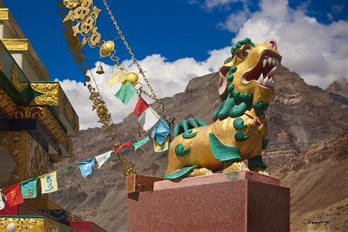 Stone sculpture of Shishi or Lion of Buddha (Buddhist guardian lion with magical properties and power to repel evil spirits) in front of ancient Buddhist monastery Tabo in Spiti (Custom).jpg