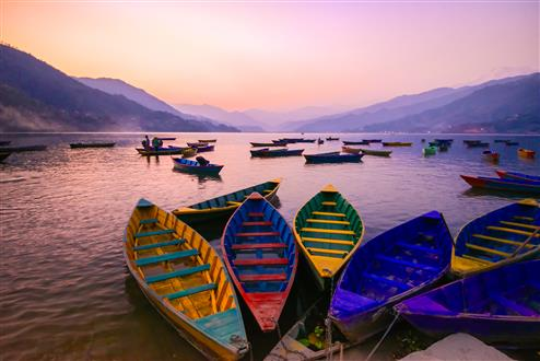 twilight with boats on Phewa lake, Pokhara, Nepal (Custom).jpg